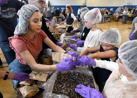 Volunteers to create and pack 10,000 meals this weekend for RRGSD Students